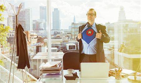 superhero - Businessman revealing superhero costume under suit Stock Photo - Premium Royalty-Free, Code: 6113-07961672