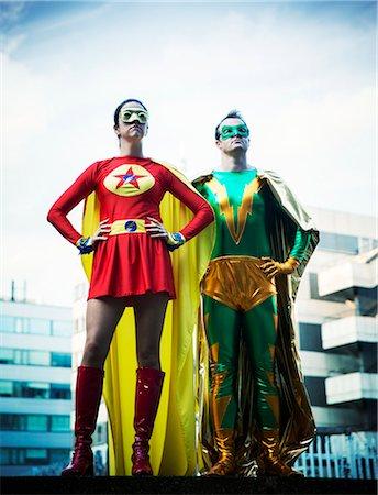 superhero - Superheroes standing on city rooftop Stock Photo - Premium Royalty-Free, Code: 6113-07961677