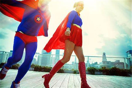 superhero - Superheroes running on city rooftop Stock Photo - Premium Royalty-Free, Code: 6113-07961682