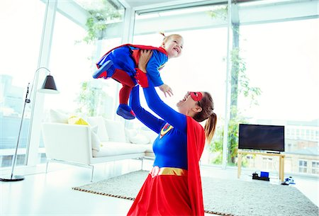 fly - Superhero playing with baby in living room Stock Photo - Premium Royalty-Free, Code: 6113-07961696