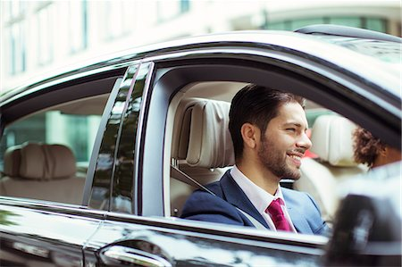 Businessman smiling in car Stock Photo - Premium Royalty-Free, Code: 6113-07961631