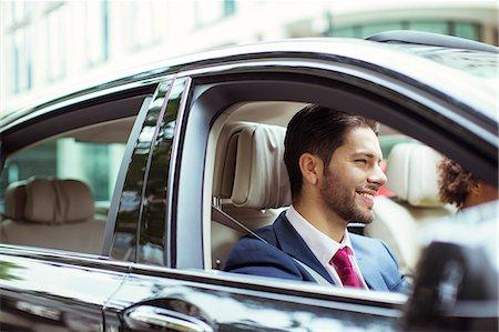Businessman smiling in car Stock Photo - Premium Royalty-Free, Code: 6113-07961631