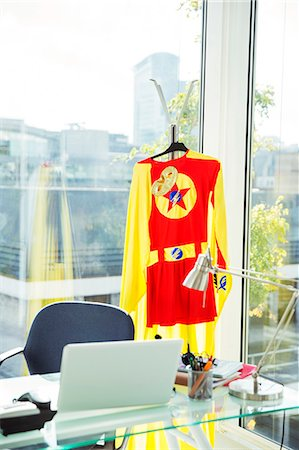 selective focus computer no people - Superhero costume hanging in business office Stock Photo - Premium Royalty-Free, Code: 6113-07961743