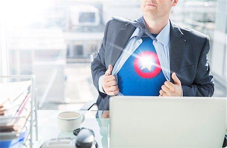 superhero - Businessman opening shirt to reveal superhero costume Stock Photo - Premium Royalty-Free, Code: 6113-07961744