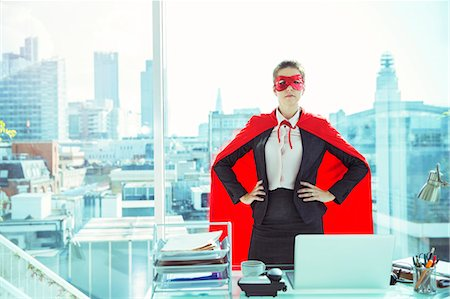 superhero - Businesswoman wearing cape and mask in office Stock Photo - Premium Royalty-Free, Code: 6113-07961745