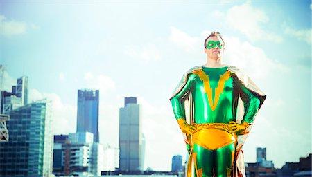 superhero - Superhero standing near city skyline Stock Photo - Premium Royalty-Free, Code: 6113-07961700