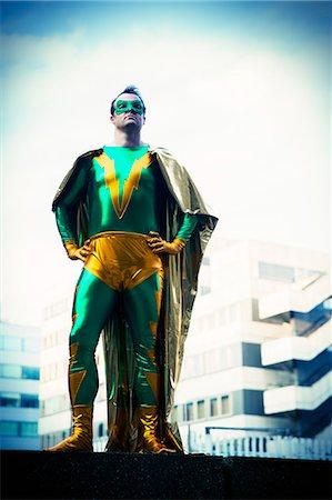 superhero - Superhero standing near city skyline Stock Photo - Premium Royalty-Free, Code: 6113-07961701