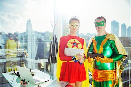 superhero - Superheroes standing in office Stock Photo - Premium Royalty-Free, Code: 6113-07961704