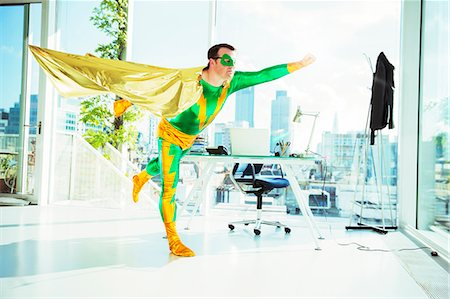 Superhero flying in office Stock Photo - Premium Royalty-Free, Code: 6113-07961711
