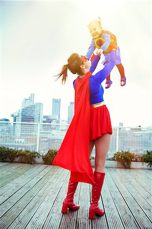 superhero - Superhero mother playing with daughter on city rooftop Stock Photo - Premium Royalty-Free, Code: 6113-07961714