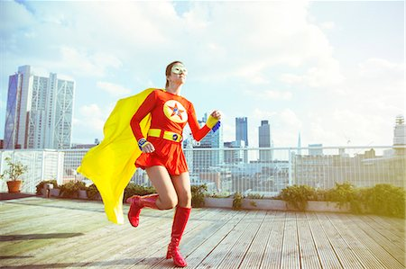 superhero - Superhero running on city rooftop Stock Photo - Premium Royalty-Free, Code: 6113-07961715
