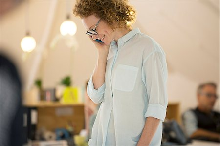 portrait looking away - Portrait of woman talking on phone Stock Photo - Premium Royalty-Free, Code: 6113-07991840