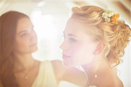 portrait looking away - Portrait of bride with bridesmaid in background in domestic room Stock Photo - Premium Royalty-Free, Code: 6113-07992196