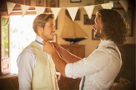 Bridegroom and best man preparing for wedding ceremony Stock Photo - Premium Royalty-Free, Code: 6113-07992119
