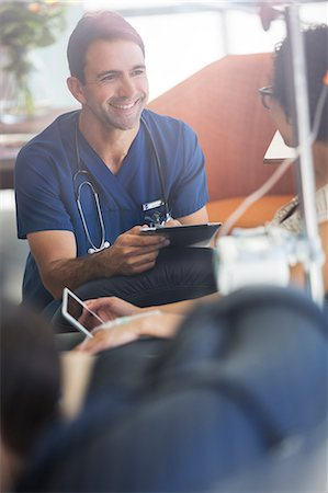 people hospital - Doctor holding digital tablet, talking to patient undergoing medical treatment in outpatient clinic Stock Photo - Premium Royalty-Free, Code: 6113-07905916