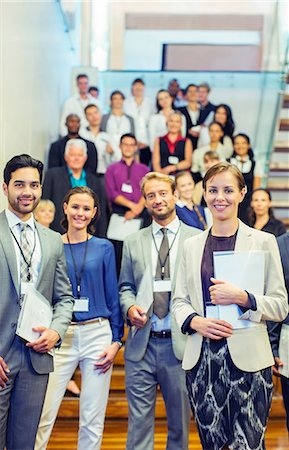Portrait of men and women standing in lobby of conference center Stock Photo - Premium Royalty-Free, Code: 6113-07906092