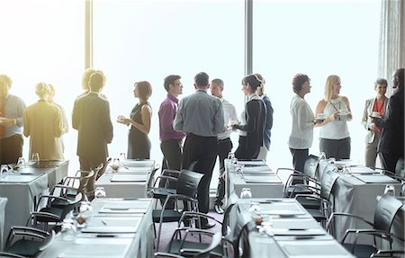 Group of people standing by windows of conference room, socializing during coffee break Stock Photo - Premium Royalty-Free, Code: 6113-07906098
