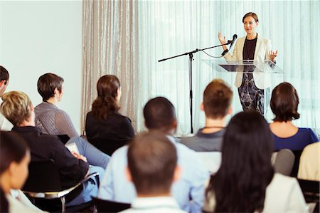 Businesswoman giving presentation in conference room Stock Photo - Premium Royalty-Free, Code: 6113-07906029