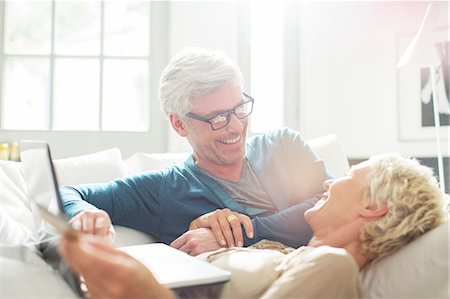Older couple relaxing together on sofa Stock Photo - Premium Royalty-Free, Code: 6113-07906171