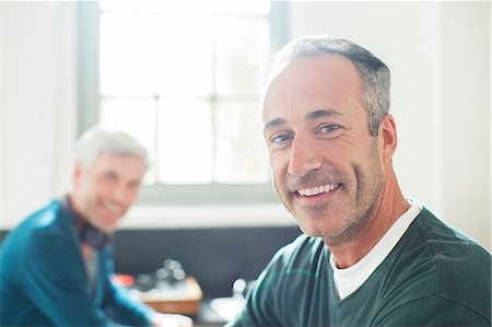 Gay couple relaxing together Stock Photo - Premium Royalty-Free, Code: 6113-07906194