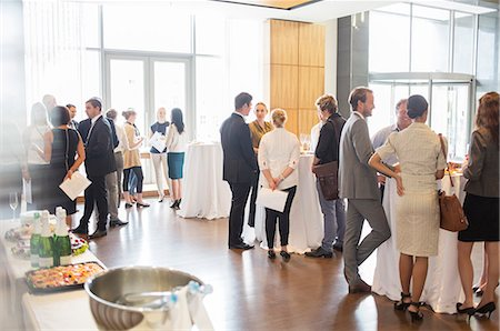 Group of conference participants standing in lobby of conference center, socializing during lunch break Stock Photo - Premium Royalty-Free, Code: 6113-07906108
