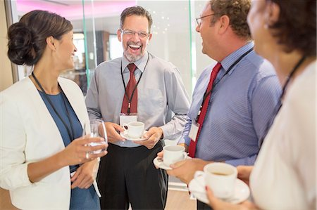 People in lobby of conference center during coffee break Stock Photo - Premium Royalty-Free, Code: 6113-07906109