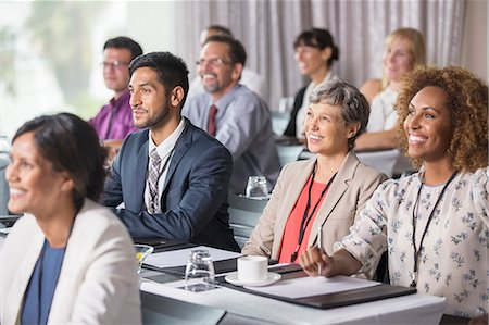 Group of people sitting and listening to speech during seminar Stock Photo - Premium Royalty-Free, Code: 6113-07906134