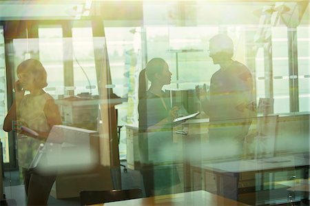 Silhouette of business people talking in office Stock Photo - Premium Royalty-Free, Code: 6113-07906242