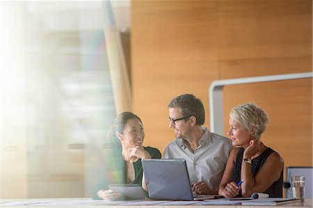 partnership - Business people talking in office meeting Stock Photo - Premium Royalty-Free, Code: 6113-07906268