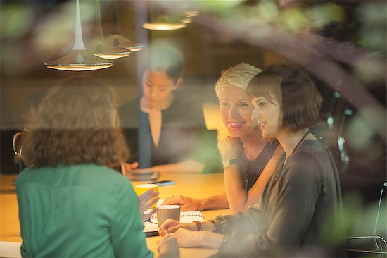 Business people talking in office meeting Stock Photo - Premium Royalty-Free, Image code: 6113-07906283