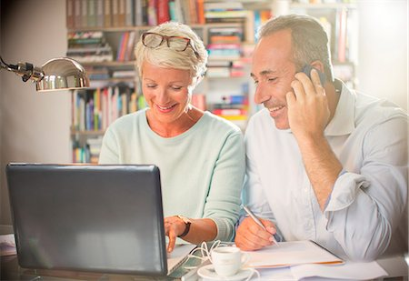 Business people working together at home office desk Stock Photo - Premium Royalty-Free, Code: 6113-07906202