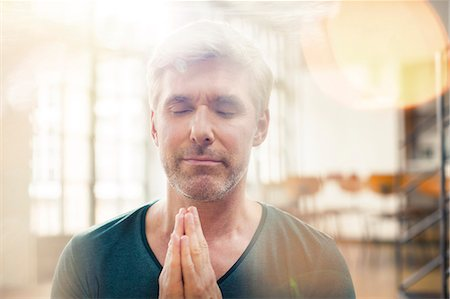 Close up of older man meditating Stock Photo - Premium Royalty-Free, Code: 6113-07906210