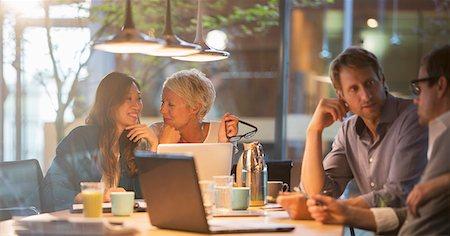Businesswomen talking in office meeting Stock Photo - Premium Royalty-Free, Code: 6113-07906220