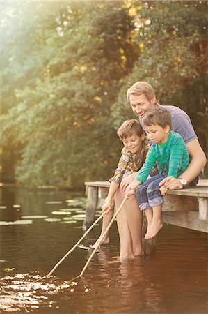 Father and sons fishing in lake Stock Photo - Premium Royalty-Free, Code: 6113-07906345