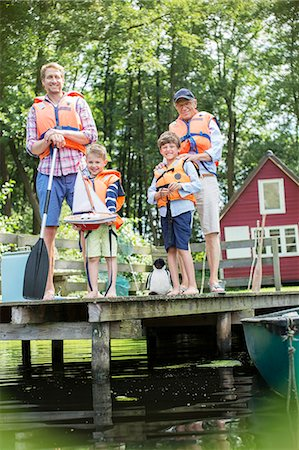 standing - Brothers, father and grandfather wearing life jackets at lake Stock Photo - Premium Royalty-Free, Code: 6113-07906359