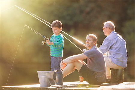 Boy, father and grandfather fishing on wooden dock Stock Photo - Premium Royalty-Free, Code: 6113-07906367