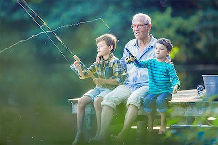 fishing - Grandfather and grandsons fishing in lake Stock Photo - Premium Royalty-Free, Code: 6113-07906377