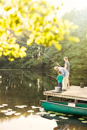 fishing - Boy, father and grandfather fishing in lake Stock Photo - Premium Royalty-Free, Code: 6113-07906375