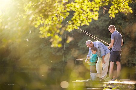 recreation - Boy, father and grandfather fishing in lake Stock Photo - Premium Royalty-Free, Code: 6113-07906384