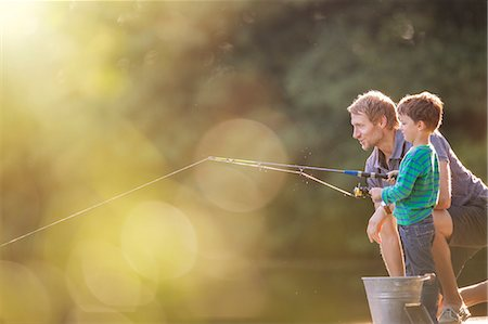 Father and son fishing in lake Stock Photo - Premium Royalty-Free, Code: 6113-07906386