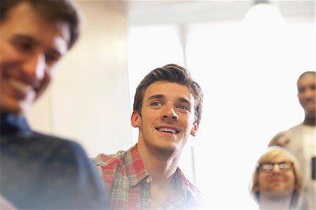 Motivated university students at seminar in classroom Stock Photo - Premium Royalty-Free, Code: 6113-07906446