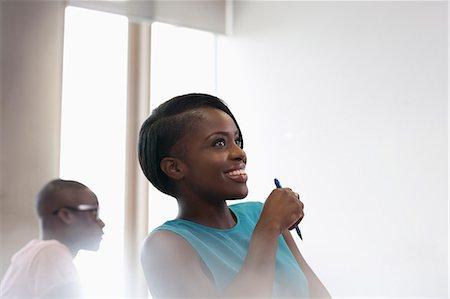 Smiling university student in blue top at seminar Stock Photo - Premium Royalty-Free, Code: 6113-07906448