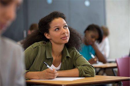 University student looking up during exam Stock Photo - Premium Royalty-Free, Code: 6113-07906465