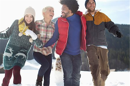 southeast asian ethnicity - Friends running in snow Stock Photo - Premium Royalty-Free, Code: 6113-07906573