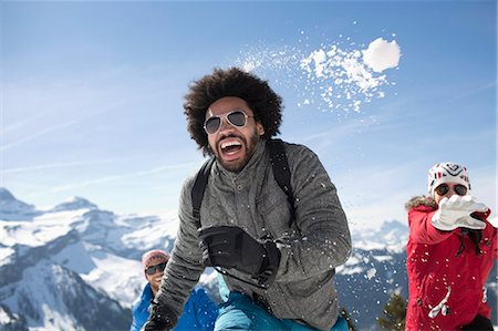southeast asian ethnicity - Friends enjoying snowball fight Stock Photo - Premium Royalty-Free, Code: 6113-07906581
