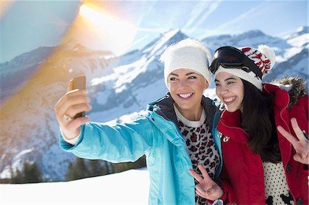filipino - Friends taking selfie in snow Stock Photo - Premium Royalty-Free, Code: 6113-07906596