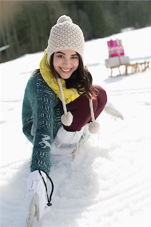 filipina - Portrait of smiling woman in snow Stock Photo - Premium Royalty-Free, Code: 6113-07906670
