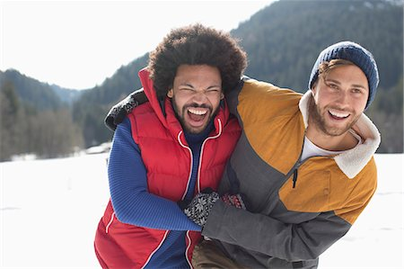 east indian (male) - Friends laughing in snow Stock Photo - Premium Royalty-Free, Code: 6113-07906627
