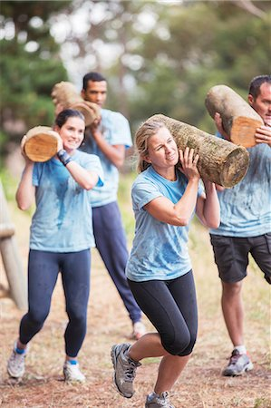 fitness   mature woman - Determined people running with logs on boot camp obstacle course Stock Photo - Premium Royalty-Free, Code: 6113-08087970