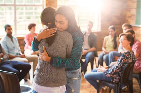 Women hugging in group therapy session Stock Photo - Premium Royalty-Free, Code: 6113-08088072